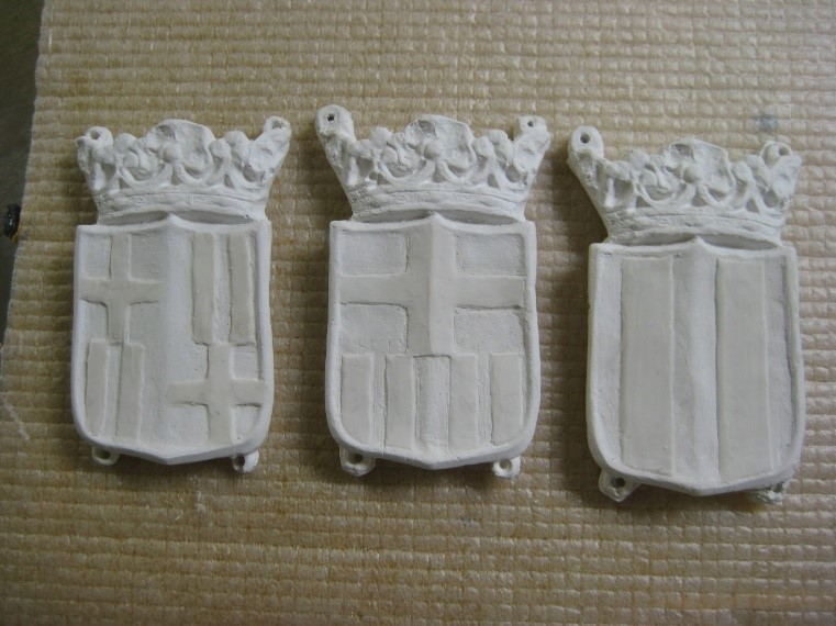 First proposals for Plasticine models of the new coats of arms on the plaster reproductions