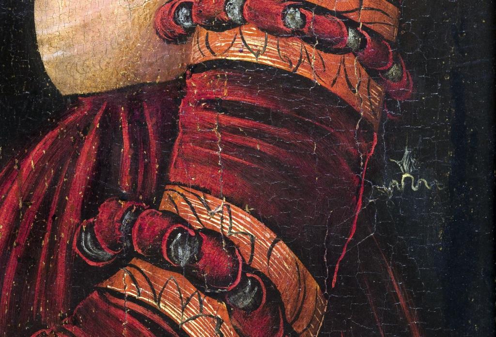Detall del drac distintiu de Lucas Cranach al braç de la noia