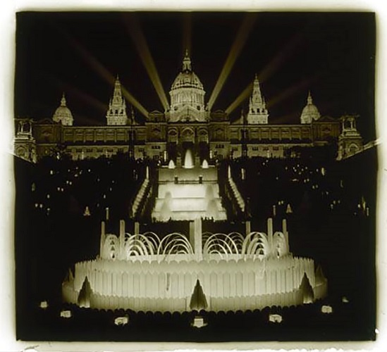 The magic fountain and the Palau Nacional illuminated at night during the Barcelona International Exposition of 1929