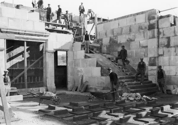 Laborers working on the construction of the Palau Nacional