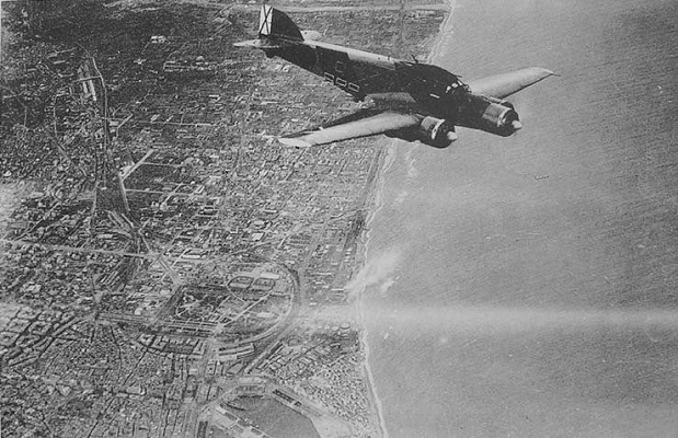 A three-engined Savoia Marchetti Sparviero (SM.79) flying over Barcelona, retreating to its base in Son San Juan, Palma de Mallorca, in the Balearic Islands