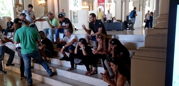 Museum audiences are increasingly using mobile. Visitors in the lobby of our museum. Photo: Maurici Dueñas